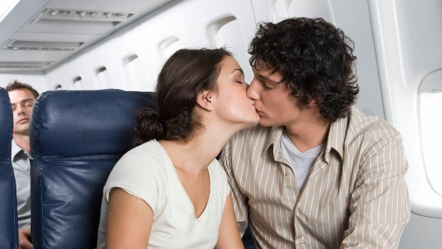 Couple on airplane. (PHOTO: Getty/Gallo Images)