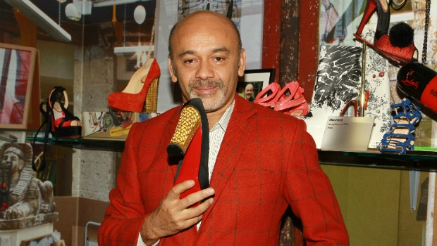 French shoe designer Christian Louboutin attends a preview of an exhibition celebrating 20 years of Christian Louboutin designs at the Design Museum on April 30, 2012 in London, England. Photo by Fred Duval/WireImage