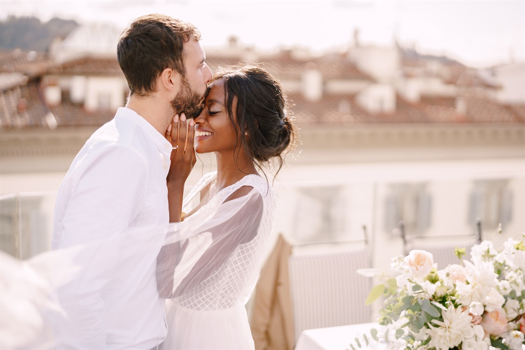 Interracial wedding couple. Destination fine-art w