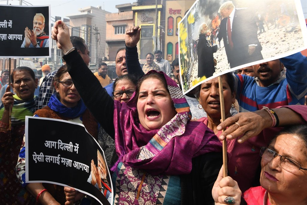 Congress Party workers shout slogans against Indian Prime Minister Narendra Modi during a protest in Amritsar,, following clashes between people supporting and opposing a contentious amendment to India's citizenship law in New Delhi. (AFP)
