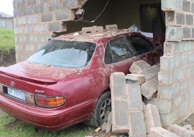Busisiwe Ngcobo and her two grandchildren had a narrow escape when a car crashed through the wall of their house. (Nompendulo Ngubane, GroundUp)