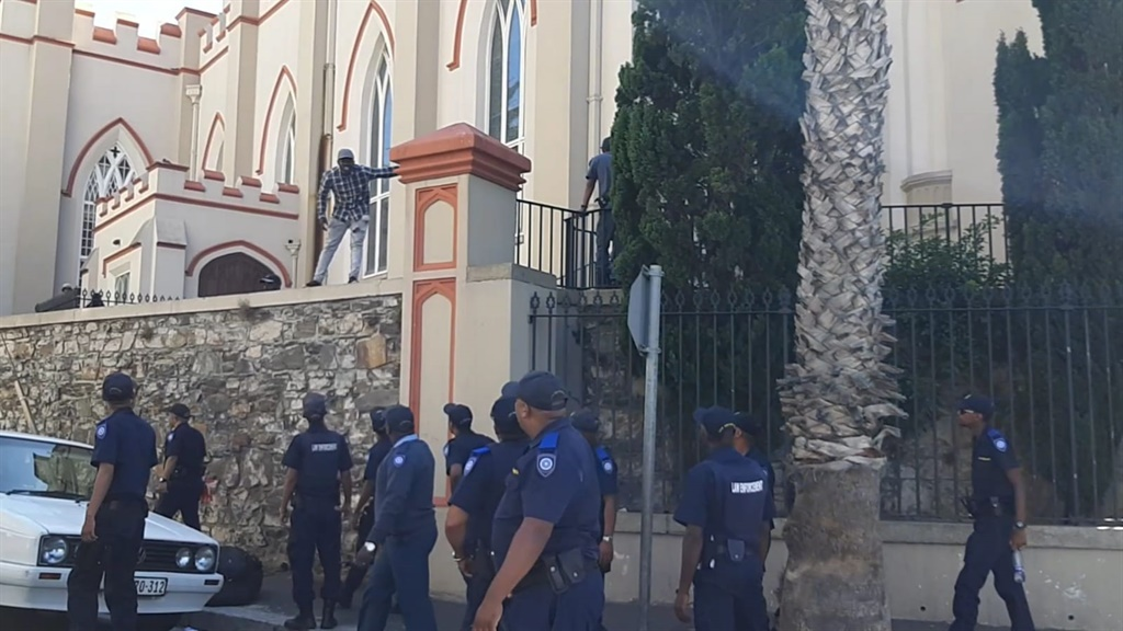 Police and City Law Enforcement remove hundreds of refugees and asylum seekers from a second church after they are removed outside the Methodist church in central Cape Town.