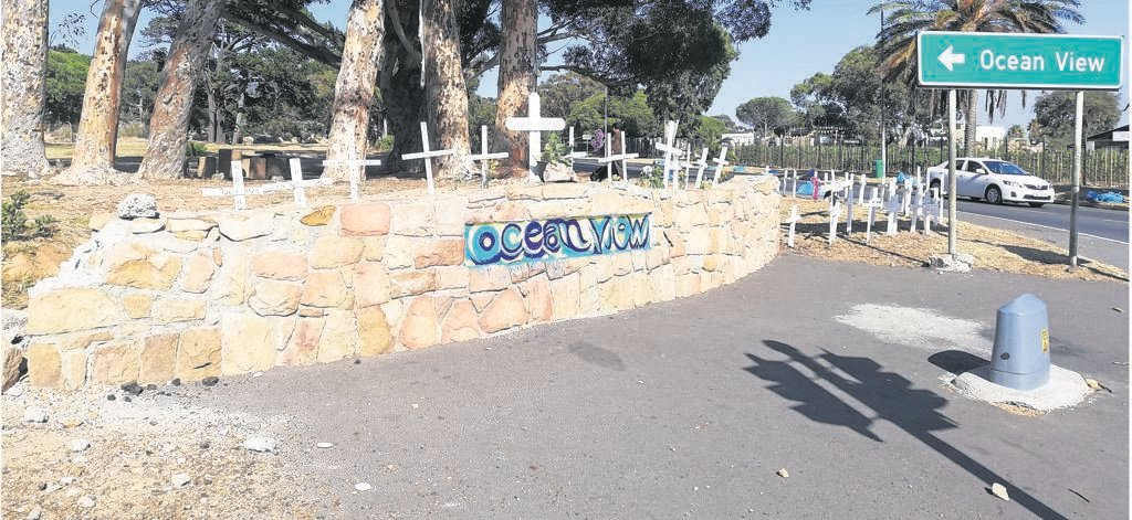 At a vigil held on Sunday 1 March, residents erected donated crosses in memory of their slain family members at the entrance of Ocean View.