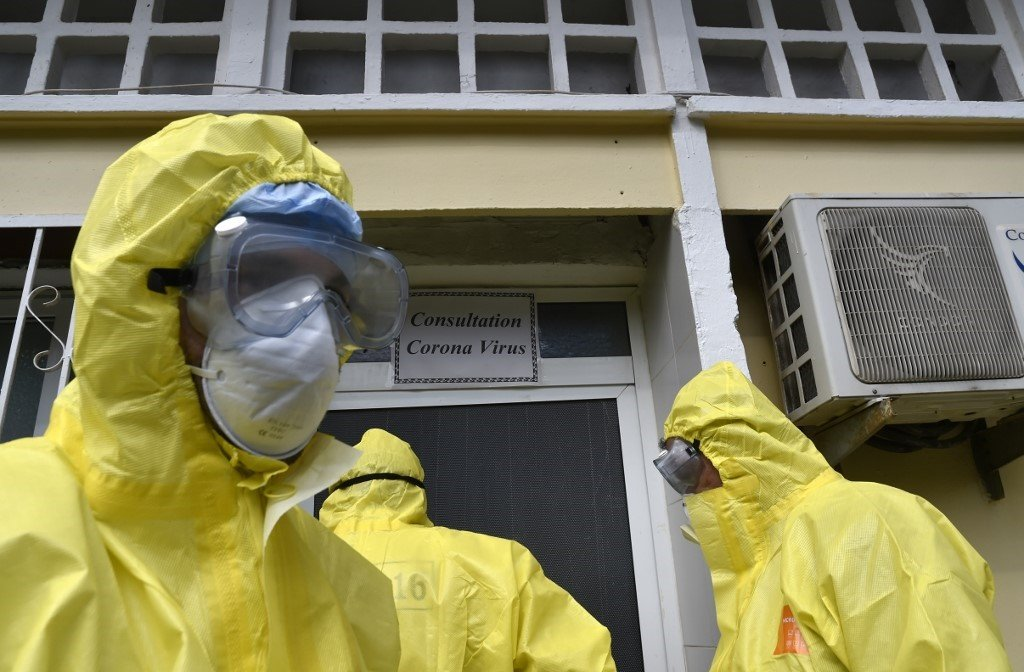 Algerian paramedics wearing protective outfits are pictured in front of El-Kettar hospital's special unit to treat cases of novel coronavirus in the capital Algiers on February 26, 2020.