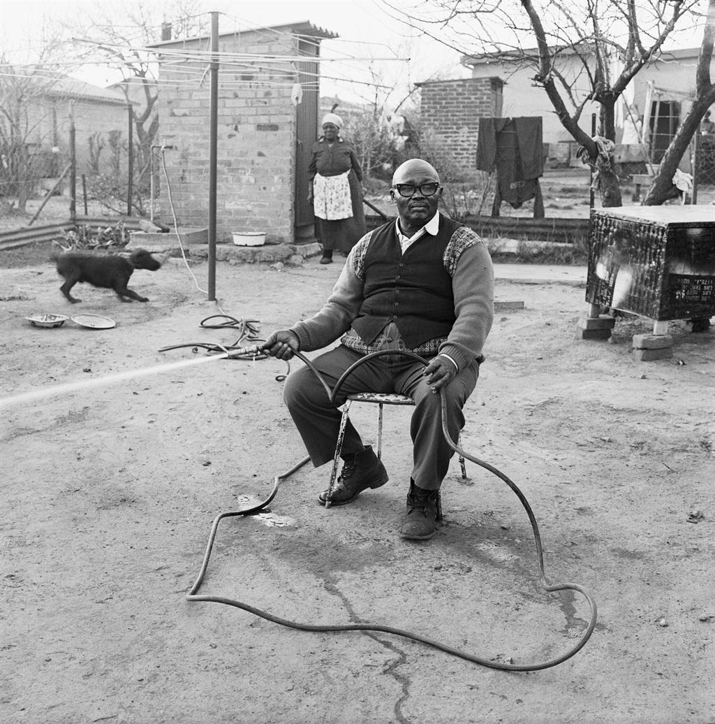 Ephraim Zulu watering his garden, 179 Central West