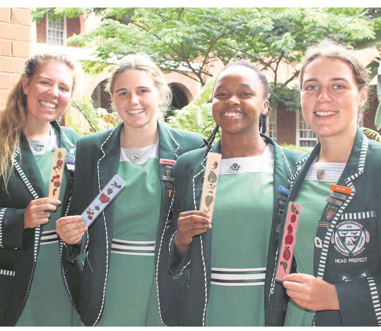 PHOTOS: SUPPLIEDPietermaritzburg Girls' High School head prefects pose with their handmade bookmarks which were posted from Cape Town by the GHS head girl in 1937, Norma Hugo.