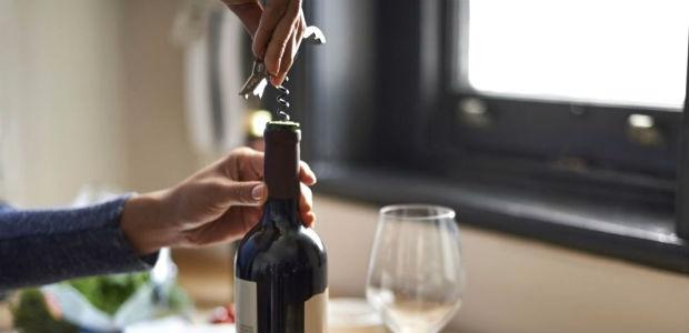 wine bottle being opened