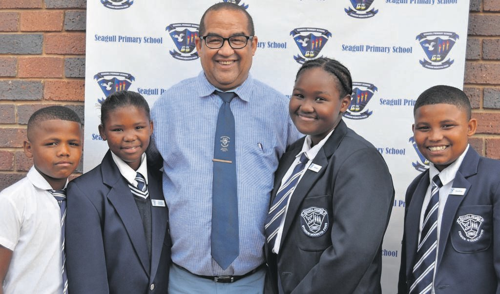 Seagull Primary head prefects together with the principal, Ettiene Terblanche (centre) are (from left) Ronaldo Tilana (deputy head boy), Keana Scheepers (deputy head girl), Sheona-Lee Blou (head girl) and Jacquin Christoffels (head boy).                       Photo:SUPPLIED