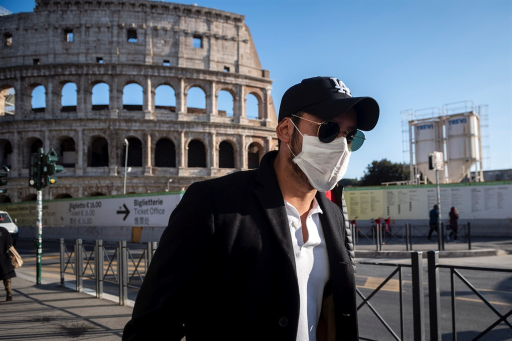 ROME, ITALY - FEBRUARY 24: A tourist wearing face