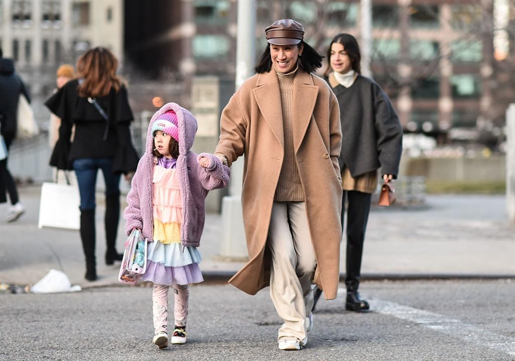 MILAN, ITALY - FEBRUARY 19: Guests seen wearing Gu
