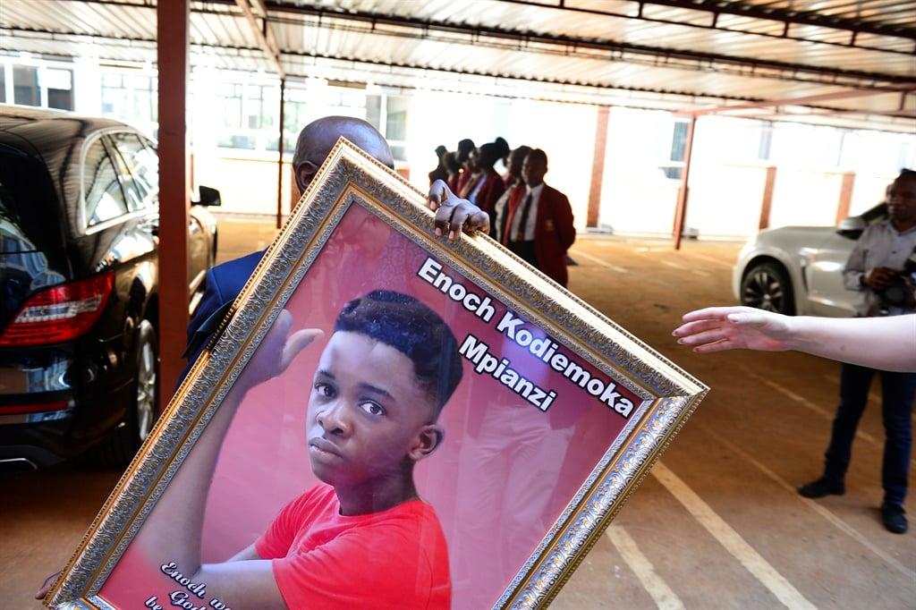 A portrait of Enock Mpianzi at his funeral.