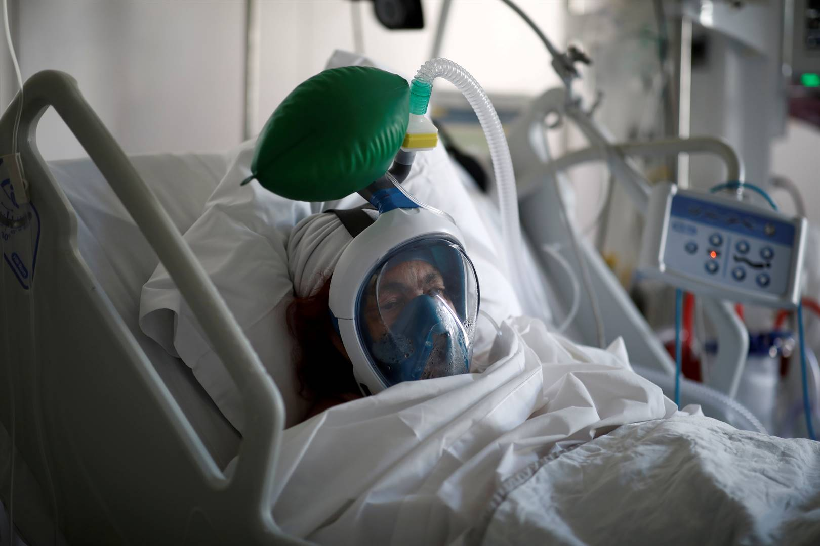 A patient suffering from Covid-19 wears a full-face Easybreath snorkelling mask given by sport chain Decathlon and turned into a ventilator for coronavirus treatment at the intensive care unit at Ambroise Pare clinic in Neuilly-sur-Seine near Paris. Picture: Benoit Tessier/Reuters