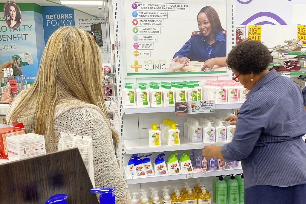 Customers shop for hand sanitisers at a store in Johannesburg, on March 6, 2020, following the government announcement on March 5 of the first confirmed case in South Africa of COVID-19 caused by coronavirus. (Michele Spatari, AFP)