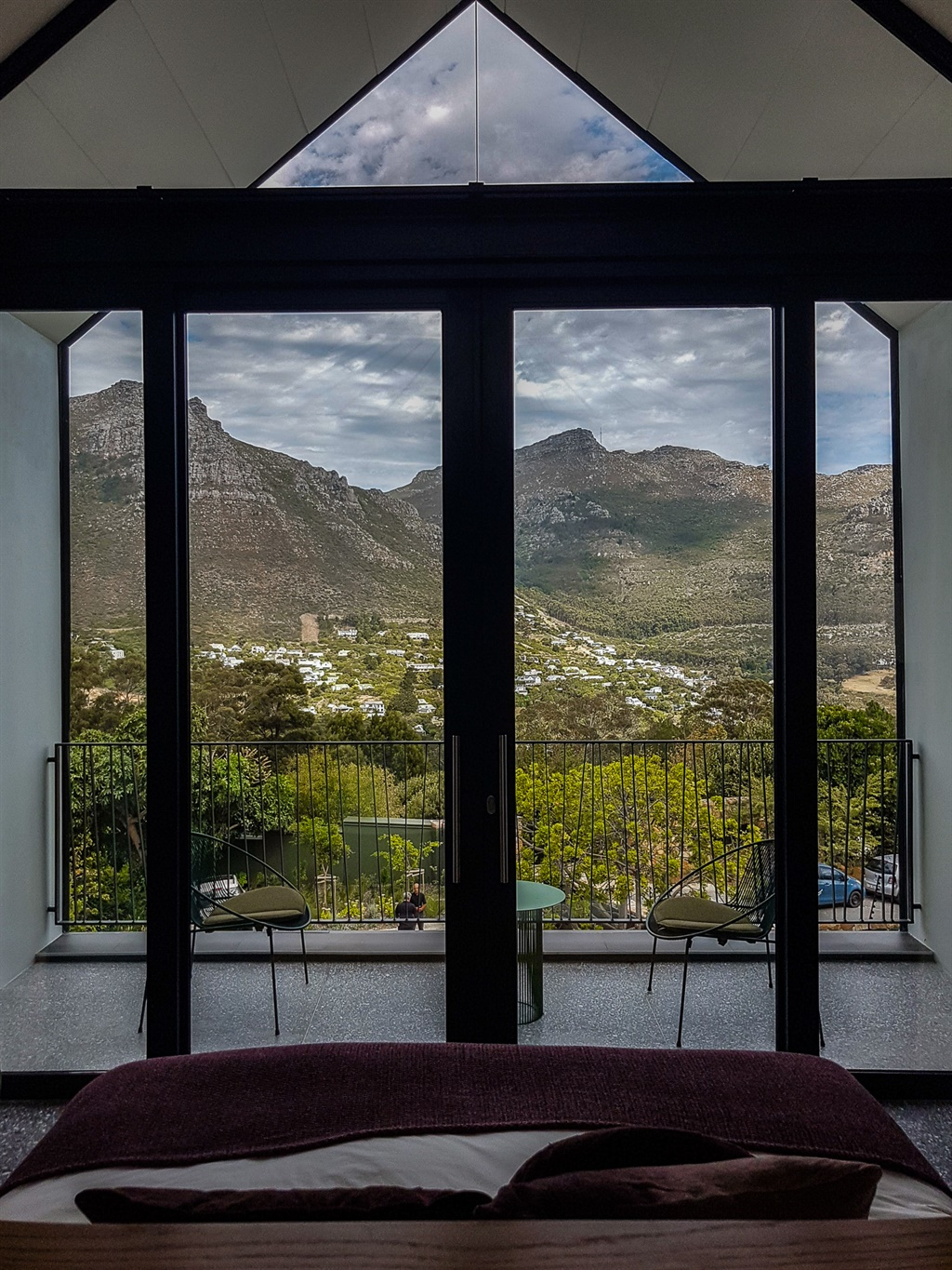 bedroom with view of mountain