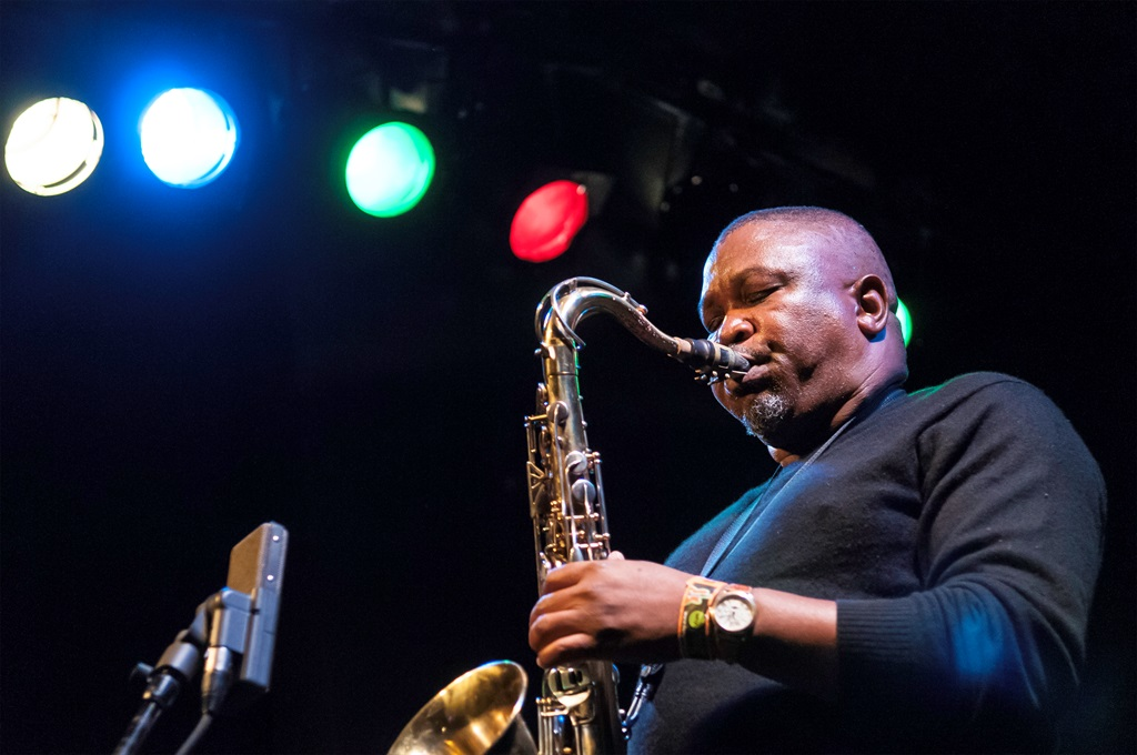 South African Jazz musician Zim Ngqawana (1959 - 2011) plays tenor saxophone as he leads his Zimology Quartet at the NYC Winter JazzFest 2008 on the Knitting Factory Main Space, New York, New York, January 12, 2008. (Photo by Jack Vartoogian/Getty Images)