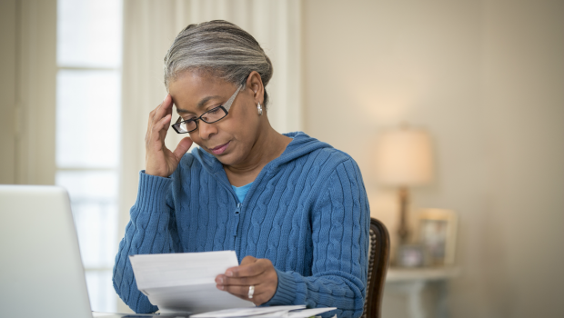 Woman worried over bills (PHOTO:GETTY IMAGES)