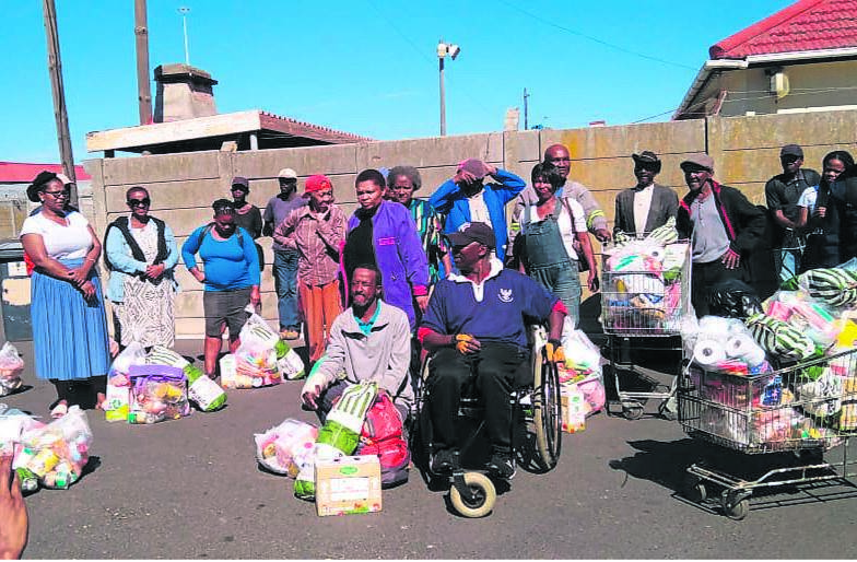 Some of the beneficiaries with their food parcels.PHOTO: