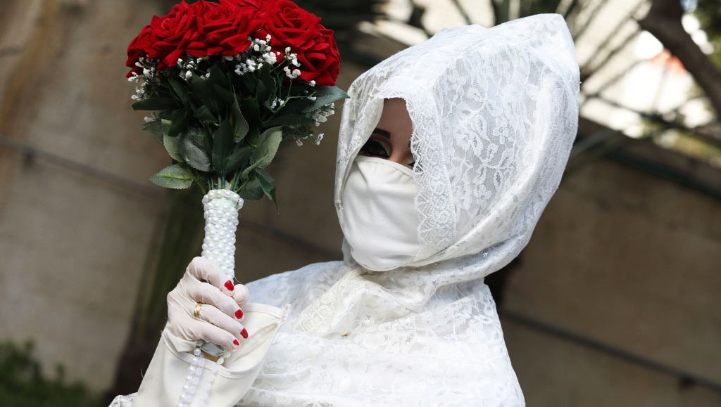 Palestinian bride Nermin wearing a protective mask