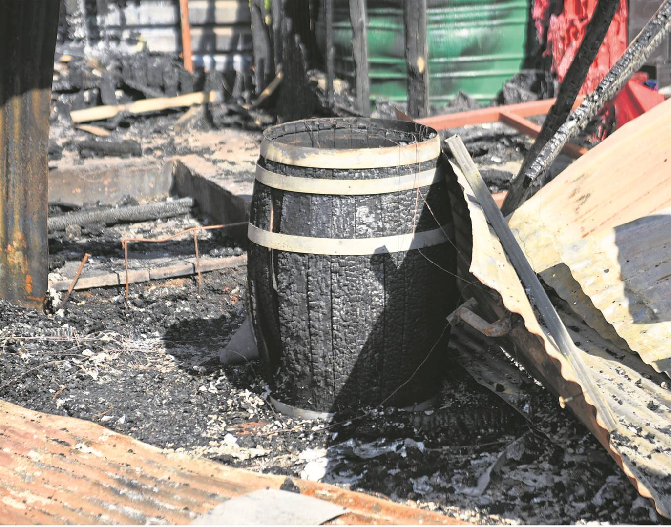 The charred ruins of the Pot and Barrel pub at the Rotunda Centre in Hilton.