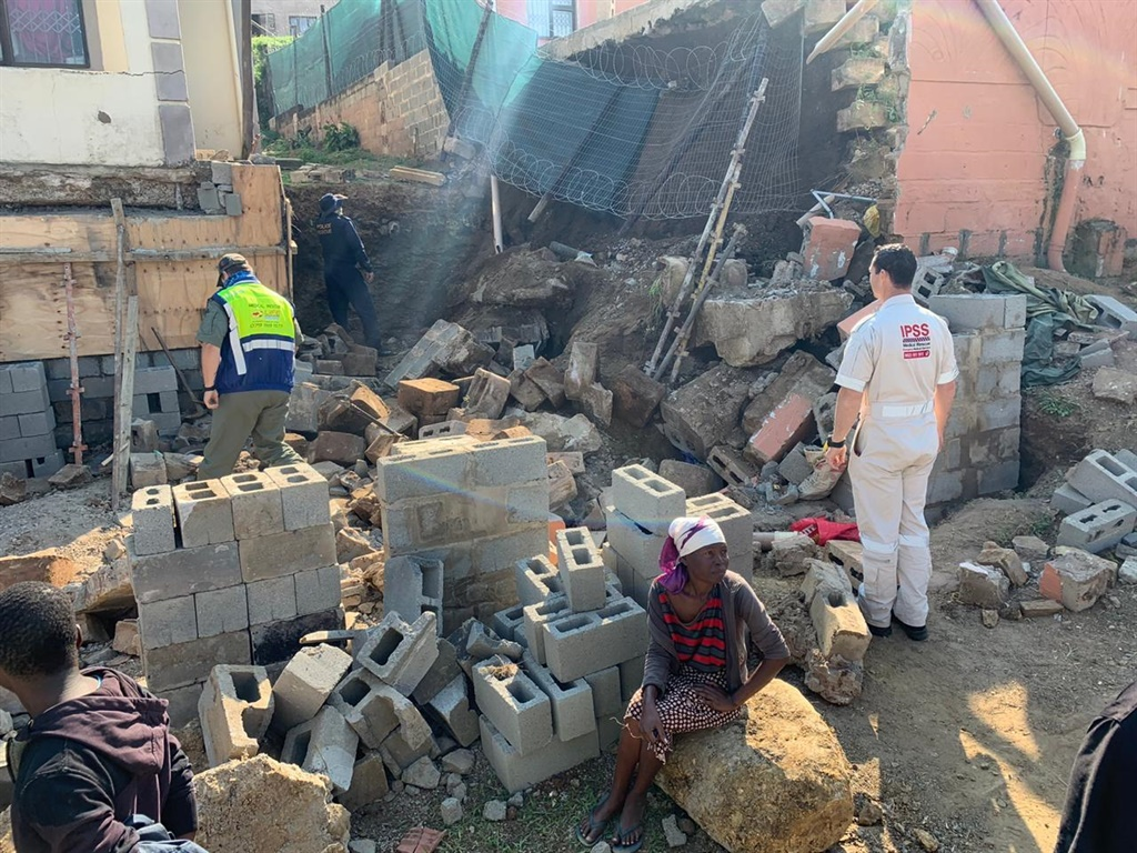 One person has died after a retaining wall collaps