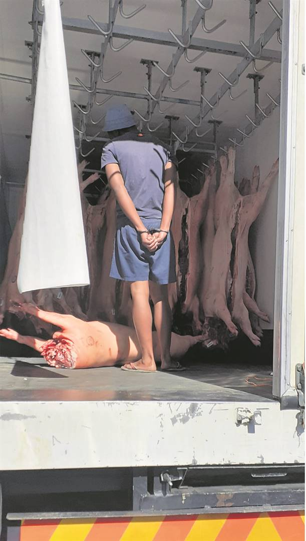 A suspect arrested for hijacking a meat delivery truck.