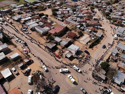 An aerial view shows residents of the Olievenhoutb