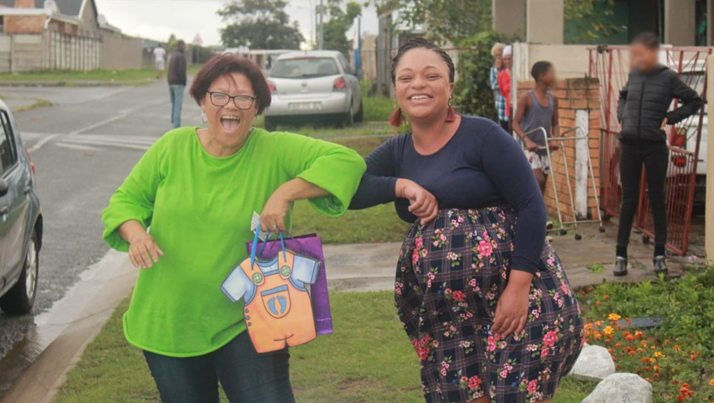 Dinika Rooy at her drive-by baby shower with a guest
