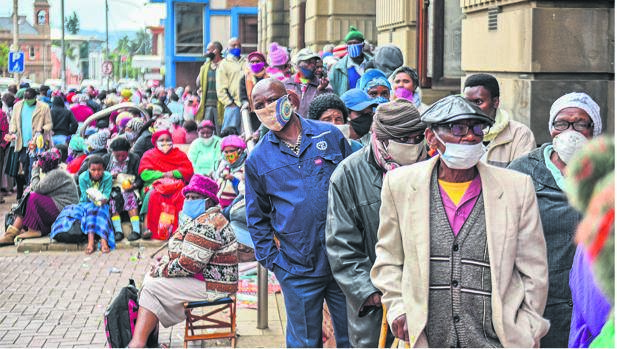 Hundreds of pensioners queuing outside the Pietermaritzburg Post Office to receive their social grants.