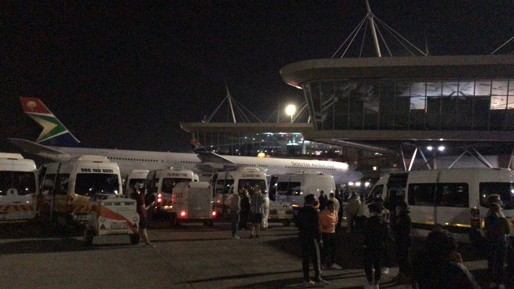 Passengers who were repatriated from the US have been on the tarmac at OR Tambo International for hours. (Supplied)