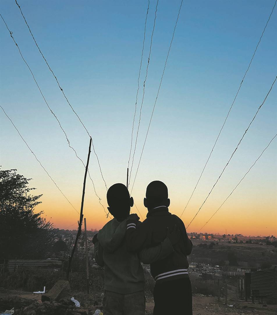 Children play under exposed electricity connections in Witpoortjie's Extension 71. These illegal connections, mainly found in informal settlements,  overburden the Eskom supply grid and have caused a number of deaths in communities that rely on illegal connection for electricity supply. Picture: Tebogo Letsie