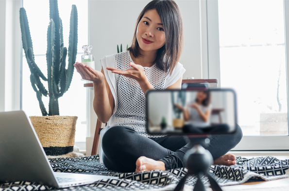 a lady filming a video on her smartphone