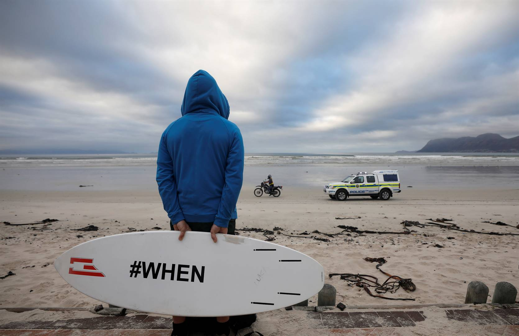 Police patrol as surfers and other ocean users protest against the nationwide lockdown regulations that allow exercise but not water activities. Picture: Mike Hutchings/Reuters