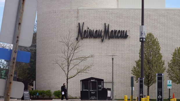 A sign hangs outside of a Neiman Marcus store that has been shuttered by the COVID-19 pandemic at Oak Brook Center shopping mall on May 07, 2020 in Oak Brook, Illinois. Photo by Scott Olson/Getty Images
