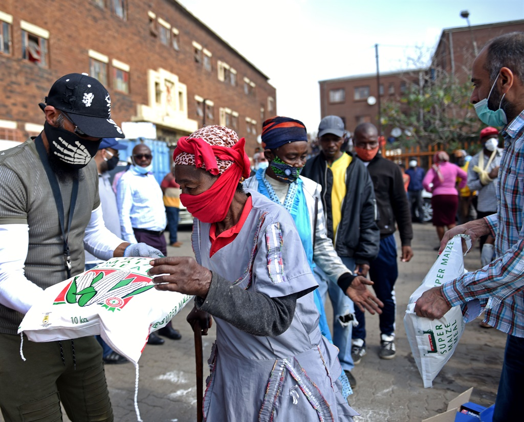 Elderly people from Denver Hostel collect food parcels donated by the Uwais Qarni Islamic Centre. Picture: Tebogo Letsie