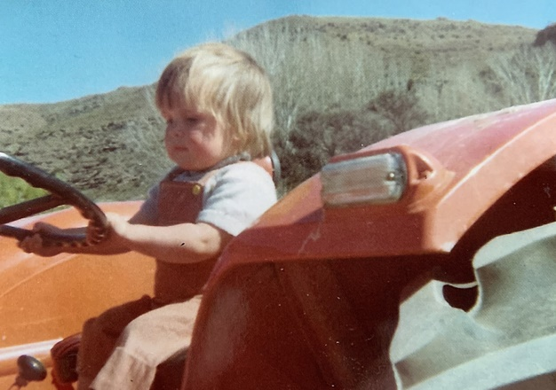 Philip Quinton on dads tractor,young driver