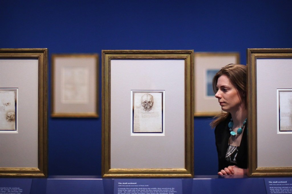 Alice Ross poses next to a drawing by Leonardo da Vinci. (Photo by Dan Kitwood/Getty Images)