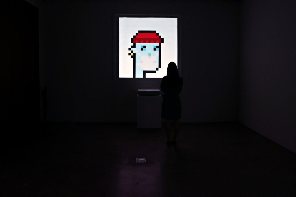An NFT titled CryptoPunk 7523 by Larva Labs is on display during a press preview of the upcoming Natively Digital: A Curated NFT Sale at Sothebys on June 04, 2021 in New York City. 2 (Photo by Cindy Ord/Getty Images)