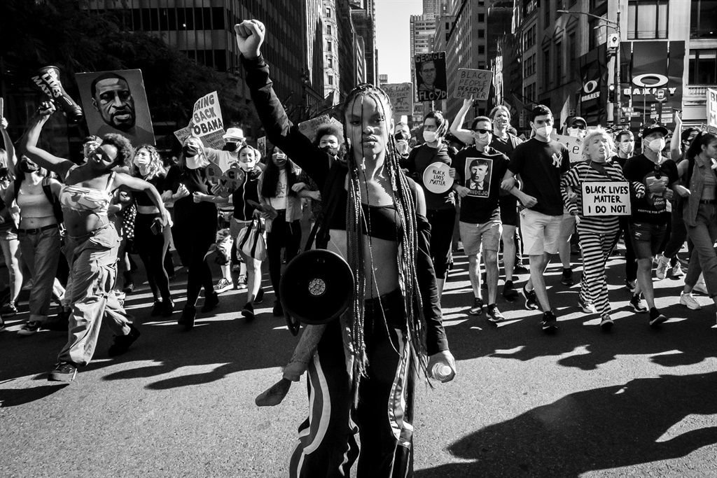 Livia Johnson, an organization leader for Warriors in the Garden holds a up her hand in a raised fist as she stands in front of hundreds of protesters as they marched from Trump International Hotel and Tower in Columbus Circle through Times Square and down 5th Avenue. Picture: Ira L. Black/Corbis via Getty Images