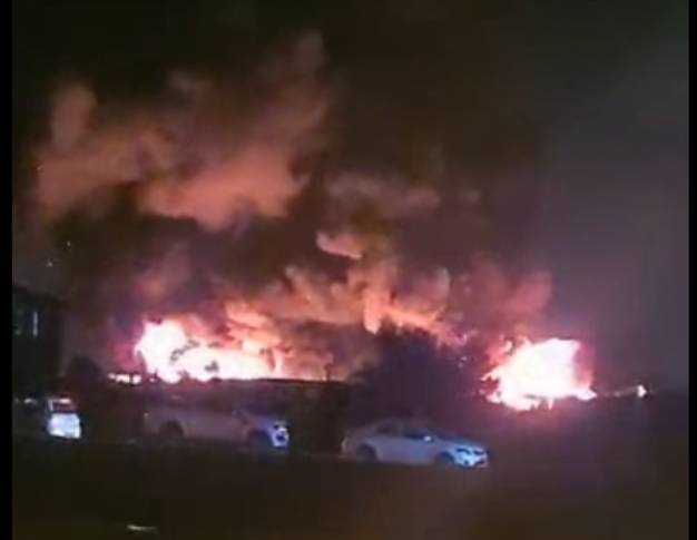 Several vehicles and car parts were destroyed in a fire.