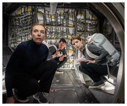 Three astronauts (Toni Collette, left, Daniel Dae Kim and Anna Kendrick) receive an unexpected guest in Stowaway. (PHOTO: Netflix)