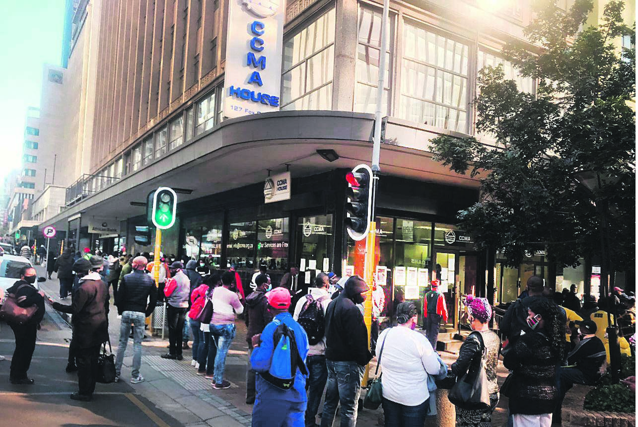 People queue outside the CCMA office in Johannesburg this week