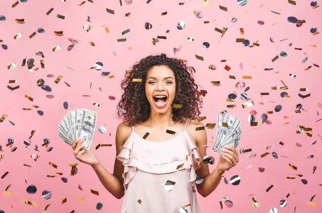Woman gets bonus. (Photo: Getty Images)