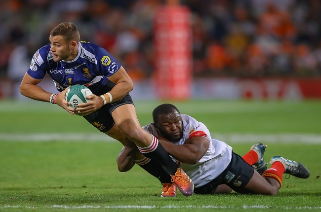 Ox Nche tackles Shaun Reynolds in last year's Currie Cup final between the Cheetahs and Golden Lions.