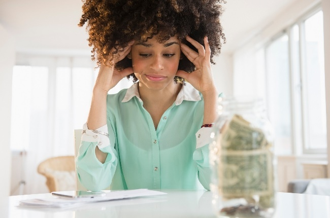 Woman stressing about her financial issues. (Photo: Getty Images)