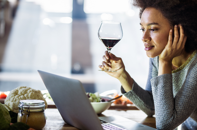 Woman drinking while on laptop (PHOTO: Getty Images)