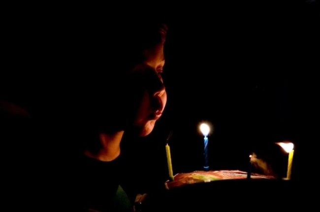 Boy blowing out candles. (Photo: Getty/Gallo Images)
