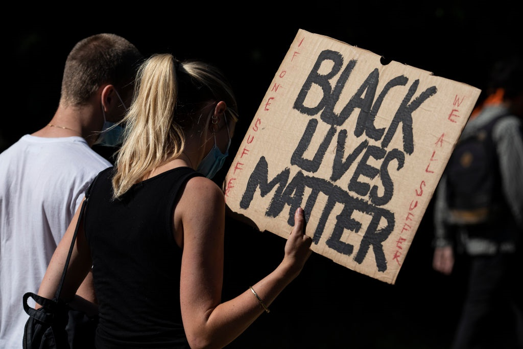 Protesters march during a Black Lives Matter demonstration in London, England, in the wake of the George Floyd killing.