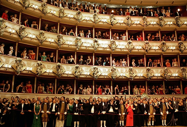"""Guests watch the opening ceremony at the annual """"Vienna Opera Ball"""" at the Vienna State Opera."""