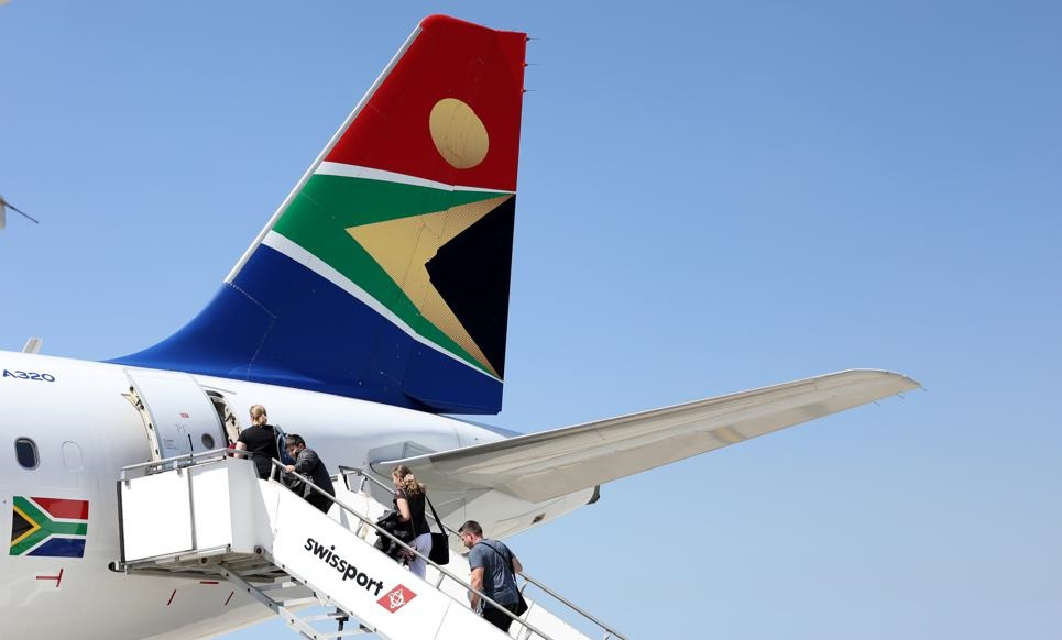 Passengers board a South African Airways (SAA) plane at the Port Elizabeth International Airport in the Eastern Cape. Picture: Siphiwe Sibeko/Reuters