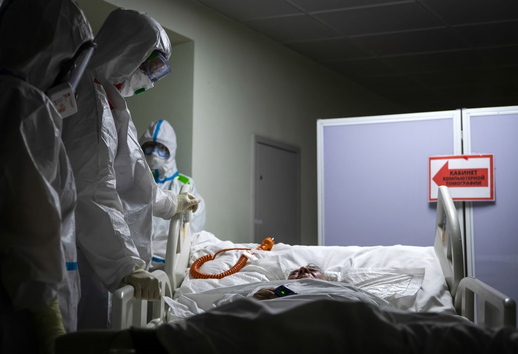 Medical workers attend to a patient in Russia.